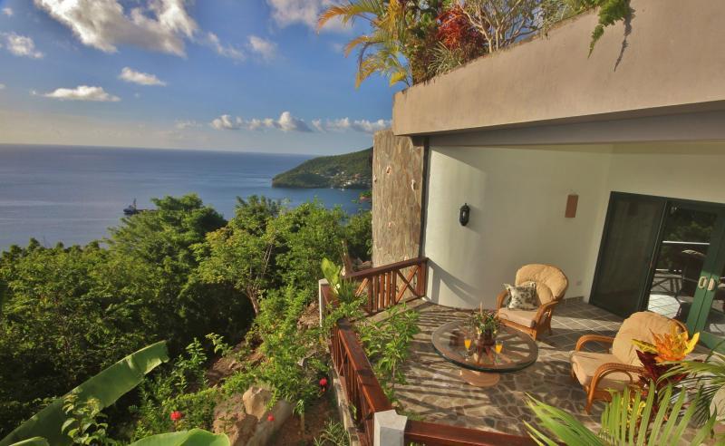 The West facing veranda has beautiful sunset and Caribbean Sea views