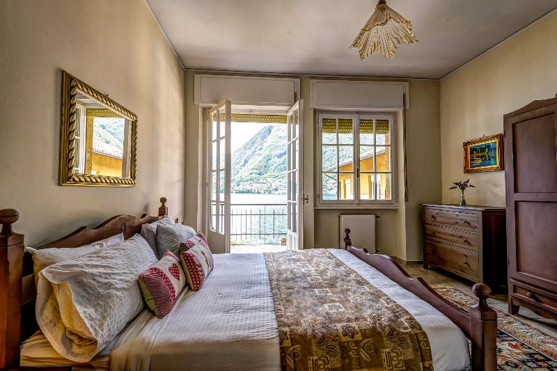 Master bedroom with private balcony and stunning Lake Como views