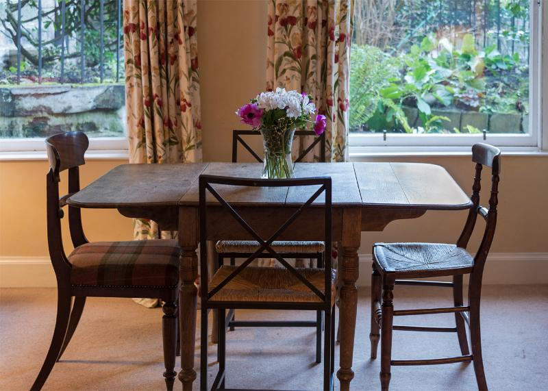 Dining table overlooking the private patio garden