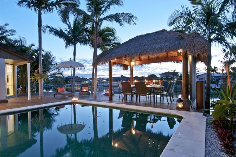 The pool and cabana - the pool is fully fenced with glass panels.