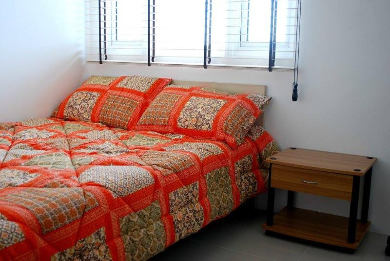 Bright and comfortable bedroom with soft and fresh sheets, which are perfect for a relaxing stay.