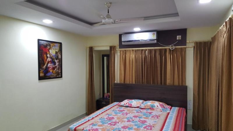 Bedroom with king size bed, ac, linens, wardrobe, safe, dressing table and blankets are provided.