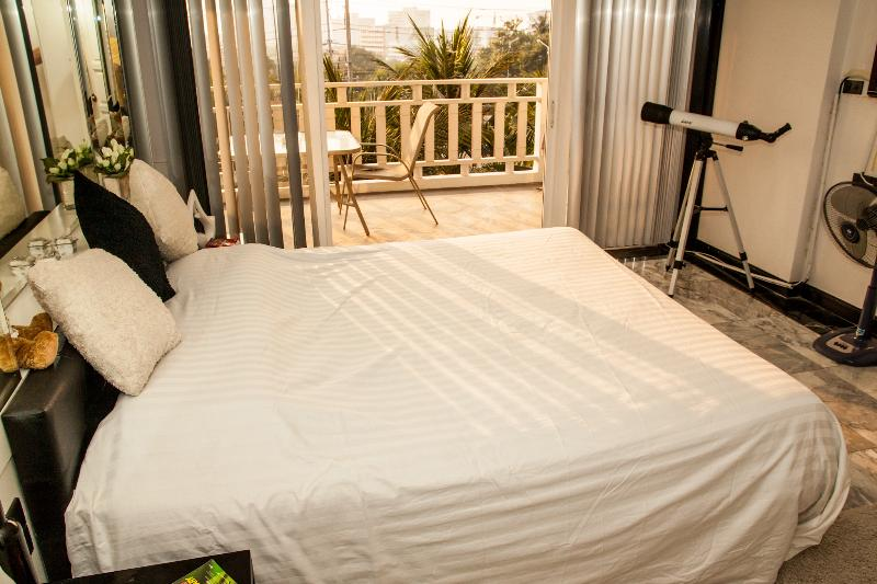 Bedroom 1 with En-suite, Balcony and Sea View.