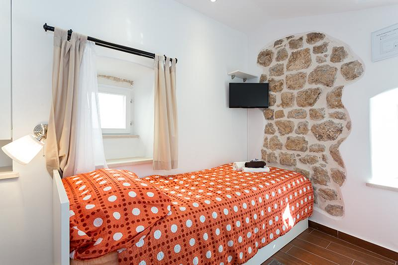 Bedroom with twin beds on first floor