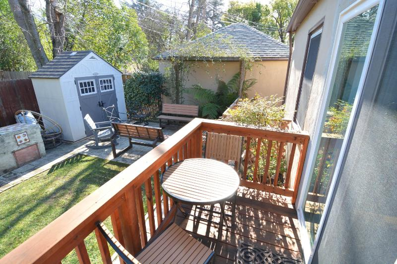Porch accessed from kitchen with table for two.