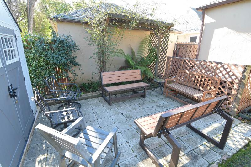 Sitting area in backyard (the faux wood benches turn into a picnic table).