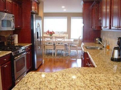 Cherry cabinets, granite counter tops and stainless steel appliances.