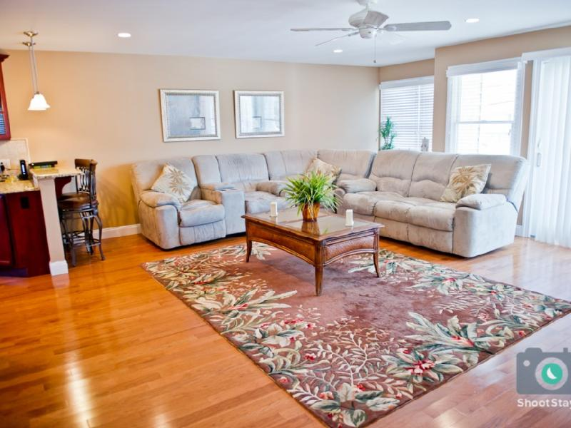 Huge family room with access to the outdoor balcony with outdoor dining table.