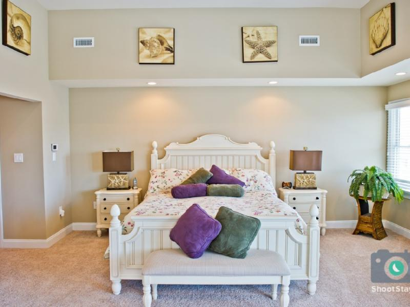 The oversized master bedroom suite with king size bed.