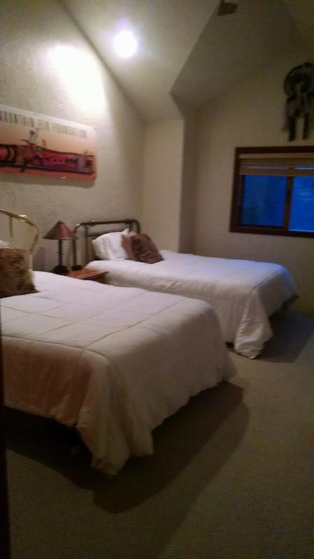 large upstairs bedroom with a queen-size bed and a full-size bed