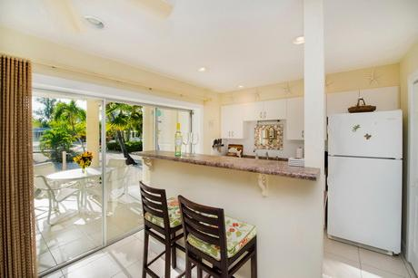 Kitchen enjoys open view of lanai and cove with access through sliding patio doors.