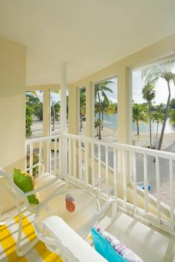 The master bedroom's private balcony overlooks Sand Pointe Cove.