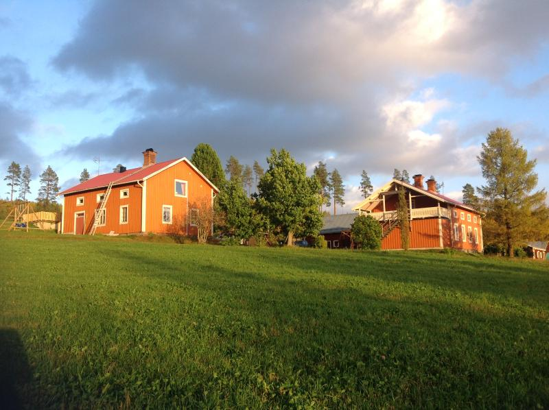 The farm. The apartment is the upper floor of the left house.