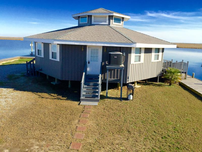 Experience the best of waterfront living when you stay at this lovely Slidell vacation rental cottage on the Geoghegan Canal.