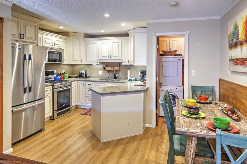 Look forward to preparing your favorite recipe in the full kitchen of this vacation rental townhome!