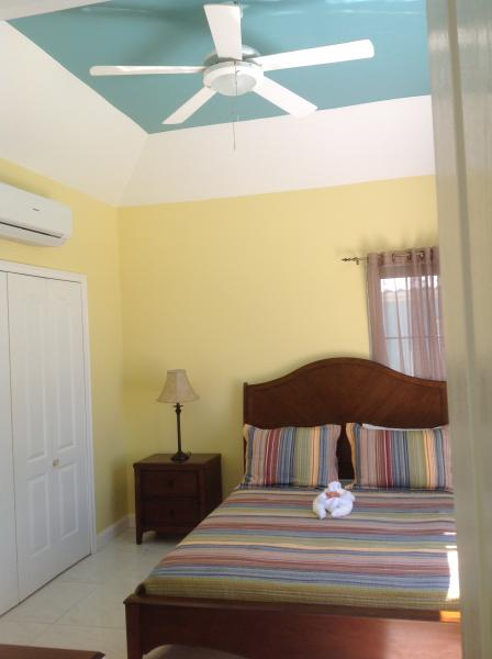 Master bedroom with a/c, balcony and insect screens