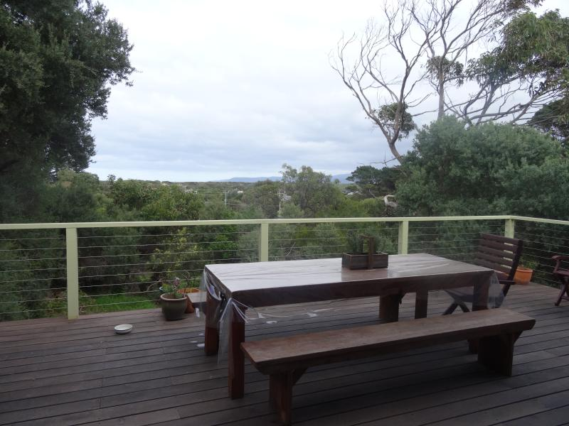 Spacious deck overlooking the trees and lorne. Perfect to relax and enjoy friends, and family with.