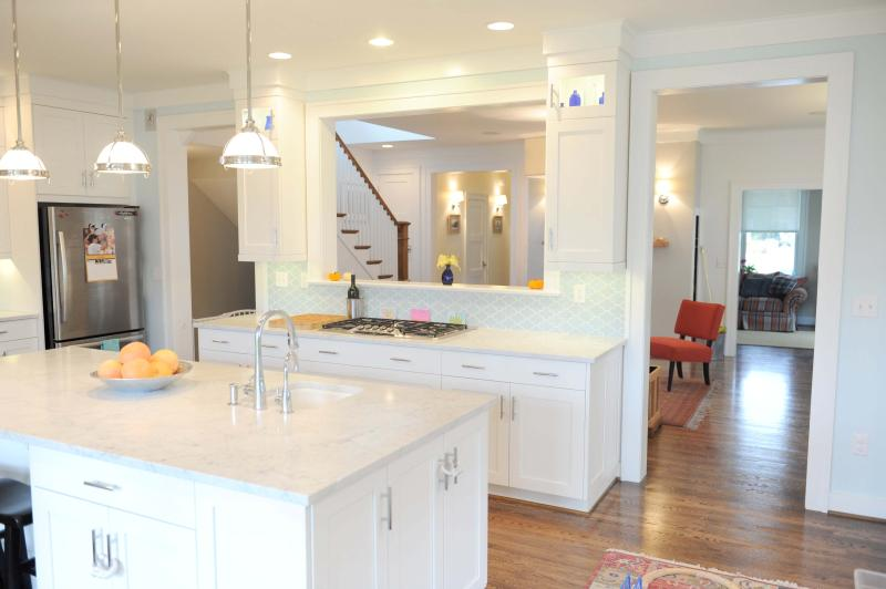 The kitchen has Carrera marble countertops and stainless steel appliances