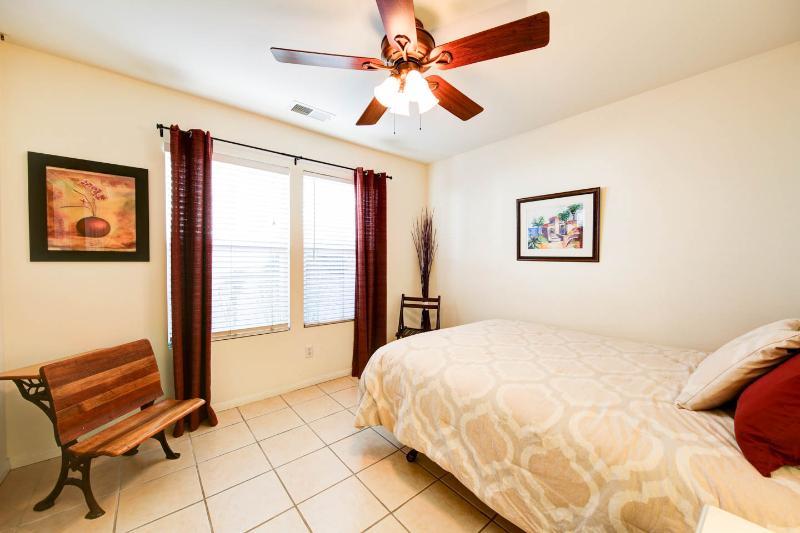 2nd bedroom with queen bed and wider doorway opening.