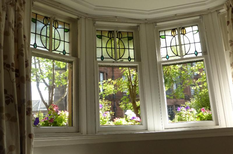 Stained glass bay window for Queensgate Garden Apartment