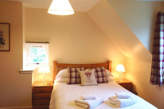 Bedroom 1 with a king size bed and views across to the Applecross hills.