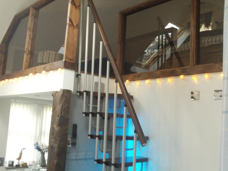Staircase access to bed deck with recessed colour change LED Lighting...