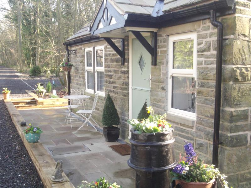 Front patio area with stable door , bistro table and chairs and views down the private approach lane