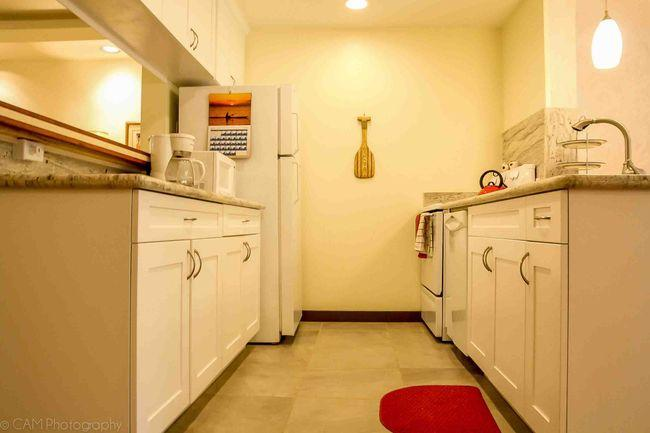 Newly remodeled kitchen includes all the necessities to create your island favorites.