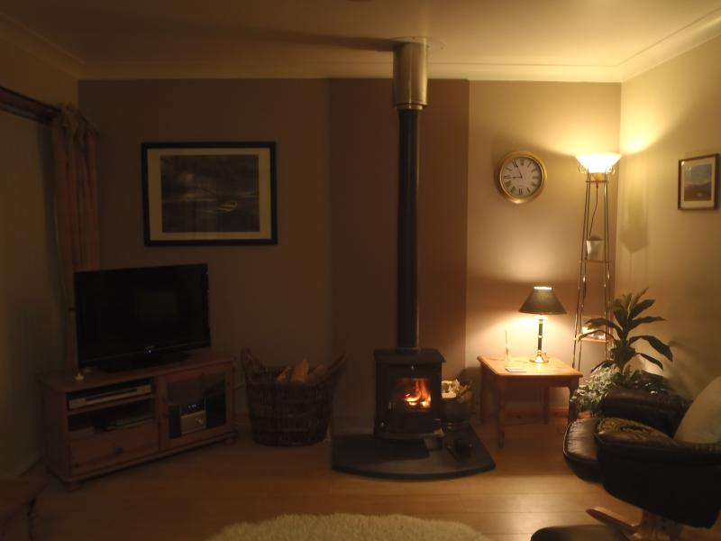 Cozy sitting room with AGA woodburner
