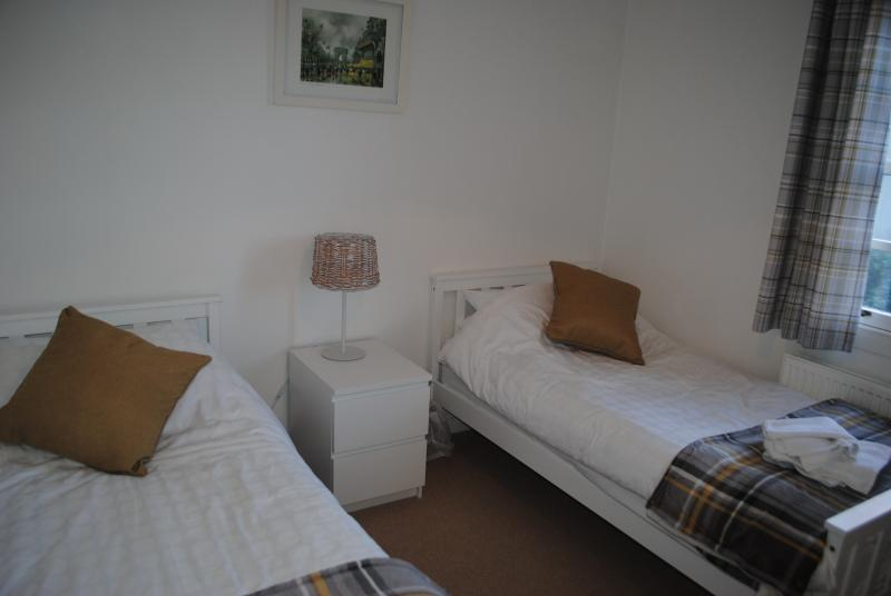 The twin bedroom has two single beds and is freshly decorated