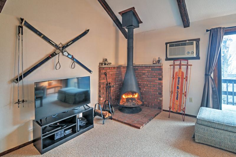 The soothing fireplace and flat screen TV will make you feel at home