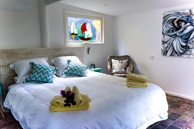 Stained glass window in master bedroom
