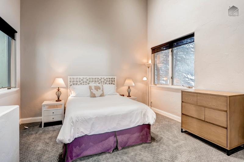An upper-level guestroom, complete with queen bed.