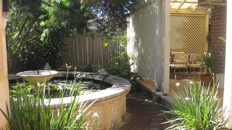 Rear courtyard - sit by the relaxing sound of bubbling water and chill!