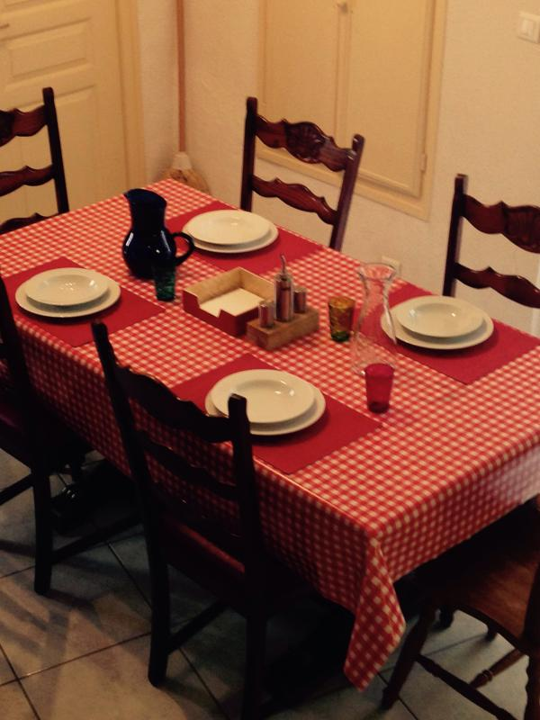 Bon Appetite! This large kitchen table extends to seat 10 .