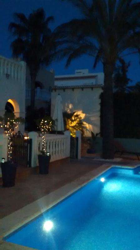 Warm summer evenings; fairy lights, pool lights and the stars!