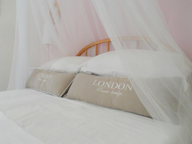 Our beautiful 'girly' bedroom...crisp sheets, stylish surroundings and super comfy bed