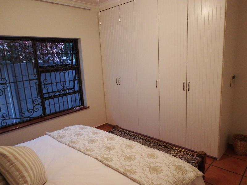 Main Bedroom with 1 x Super King Size bed and spacious built in cupboards.
