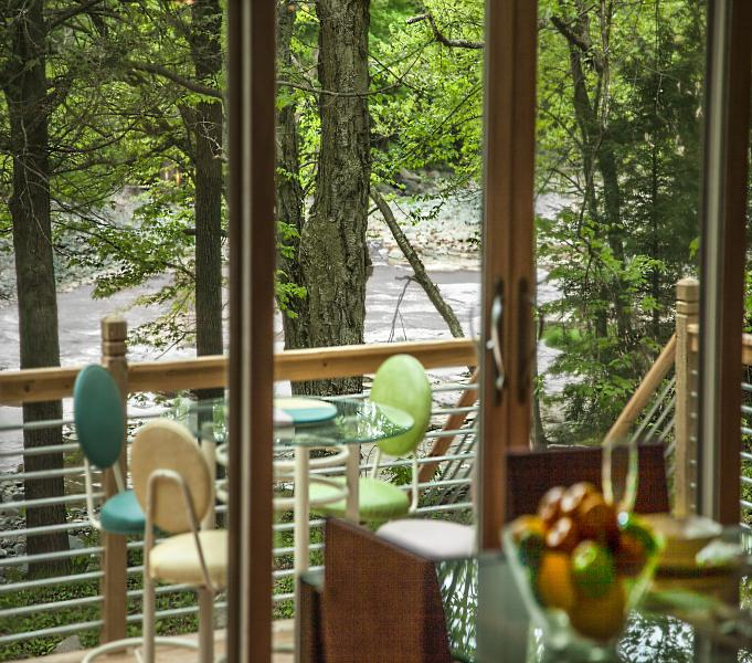 Enjoy a beautiful  streamside deck off the open concept kitchen