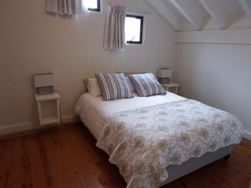 Second bedroom with 1 x Queen Size Bed and built in cupboards and dressing table.