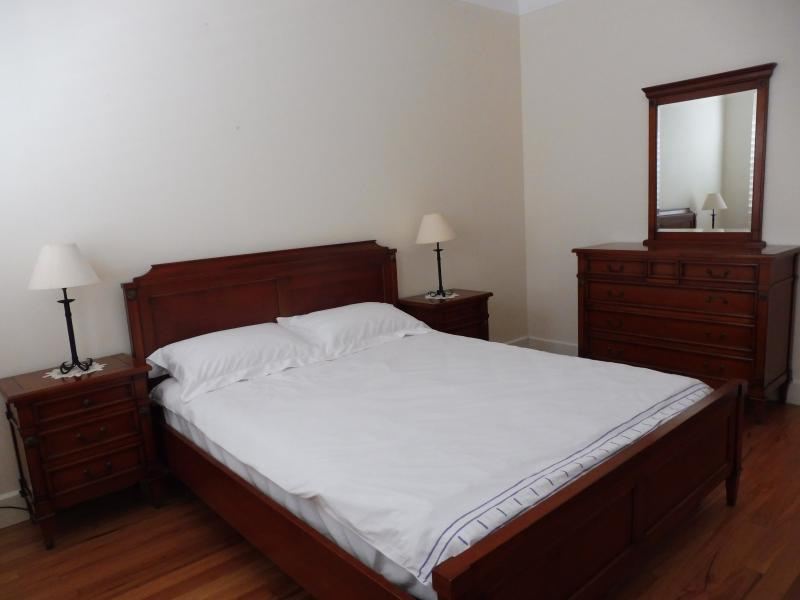 Master bedroom with rosewood furniture and queen size bed