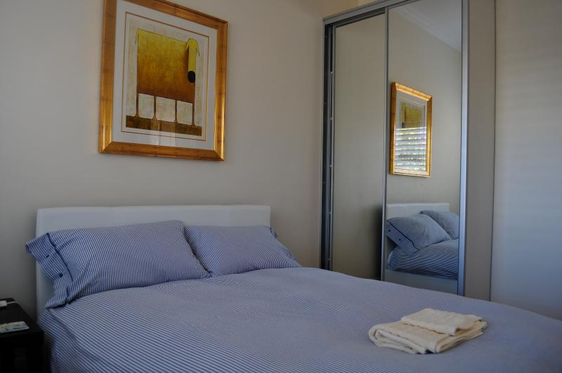 Bedroom with double bed and built-in wardrobe