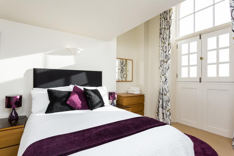 Master Bedroom, downstairs with en suit. Stable doors open wide to a view accross the city .
