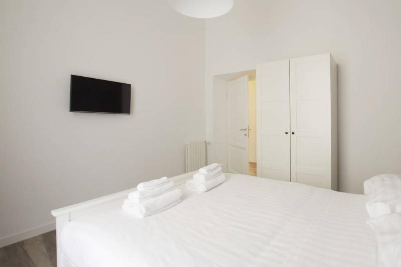 White Bedroom with Double bed, TV and closet