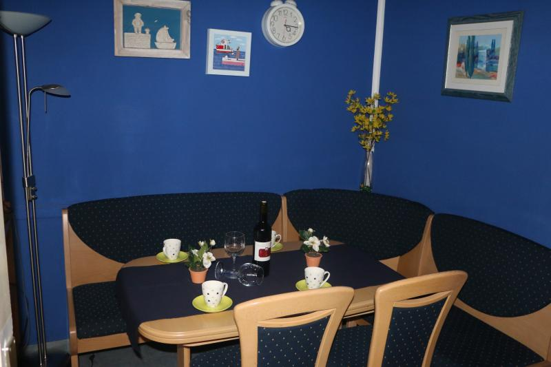 Dining room with seating area and flat-screen TV.