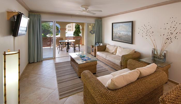 The open plan living area flows out onto the airy patio which has additional lounge chairs and al fresco dining