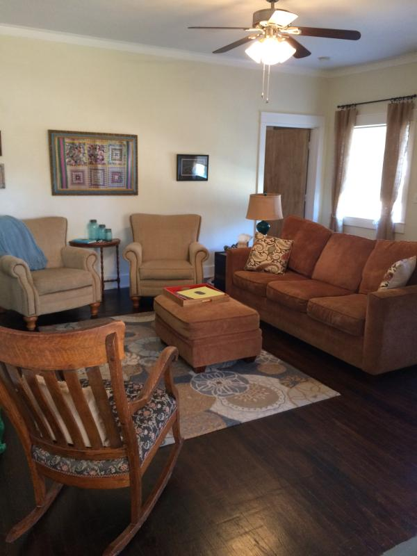 living area with sleeper sofa and tv