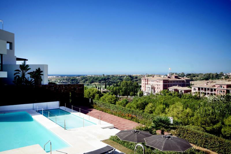View from the terrace to the golf course and The Villa Padierna Palace