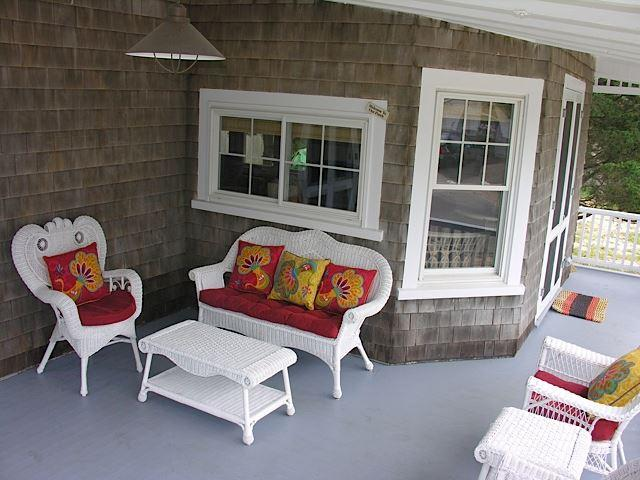 The porch has seating for 10. Real antique wicker some pieces are 100 years old.