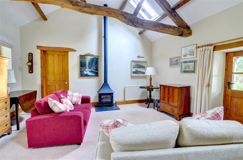 The comfortable sitting area has two good sofas and a woodburning stove